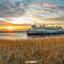 Teso haven Texel tijdens zonsondergang.